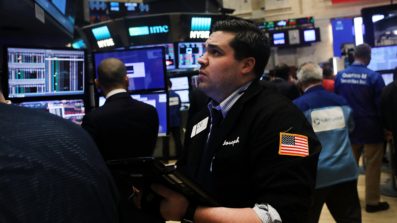 Wall Street Trader at NYSE watches Dow Jones-159532.jpg12582002