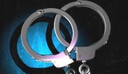 Handcuffs hand cuffs arrested teal turquoise_1558817874633.jpg.jpg