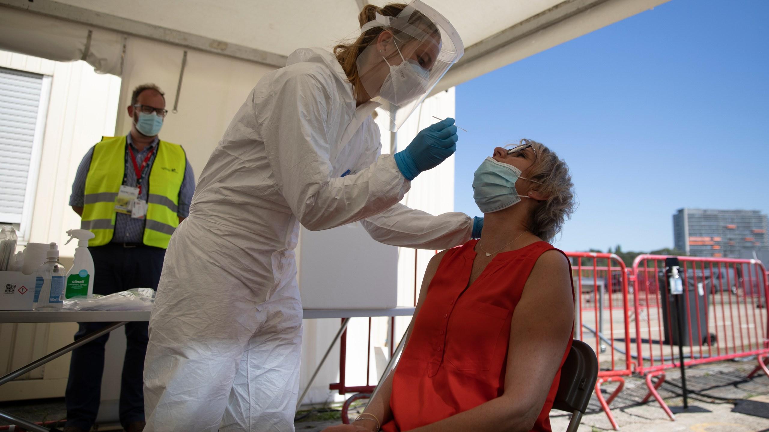 nurse giving a COVID test